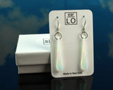 White Aurora opal teardrop dangle earrings on gift box