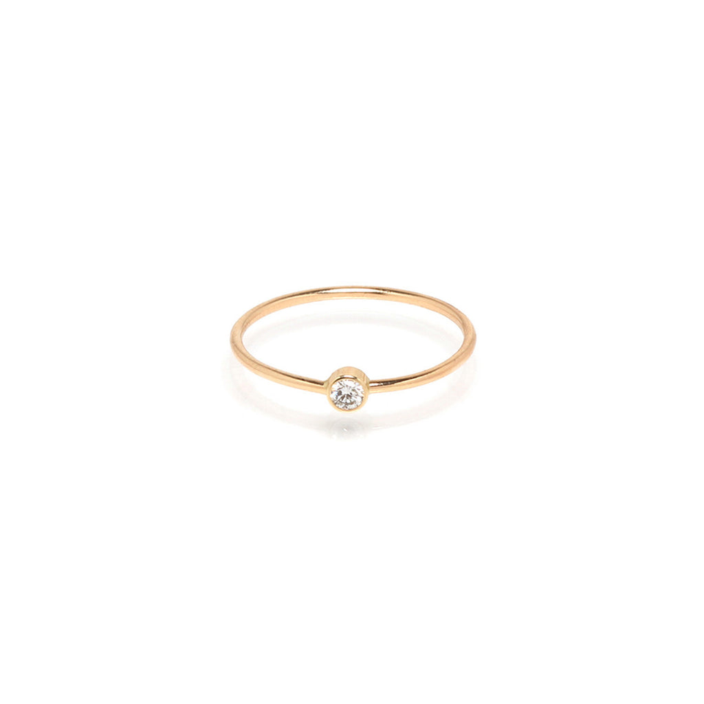 Single diamond bezel ring by Zoe Chicco