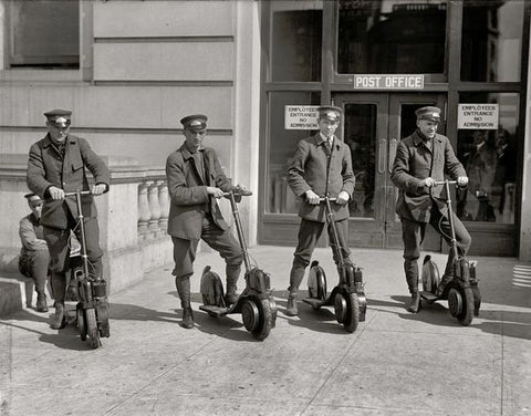 old mail men on electric scooters