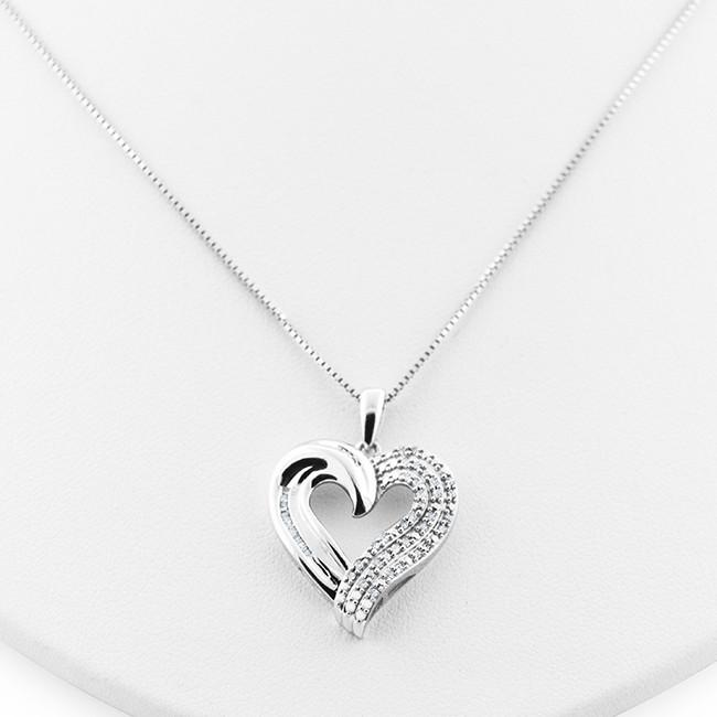 1/4 Carat Diamond Heart Pendant in Stering Silver with Chain