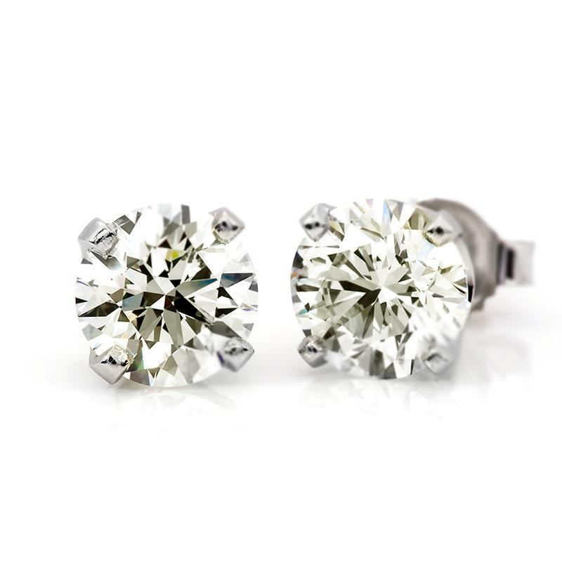 Near 3/4 Carat (.65ctw) Diamond Stud Earrings in 10K White Gold (I-J;I2-I3)