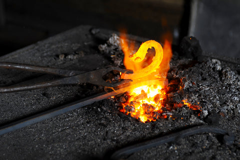 Heating Metal In a Hot Forge at Borderland Rustic Hardware for Authentic Decorative Metal, Steel, Iron, Forged DIY projects and crafts made in the US and Mexico in 2021