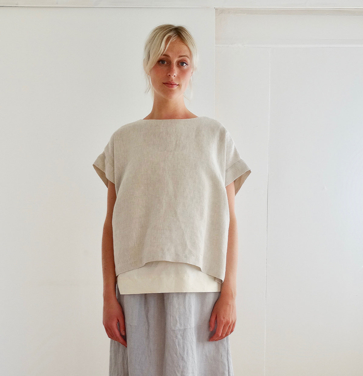 model wearing pajottens sustainable  oatmeal linen overtop