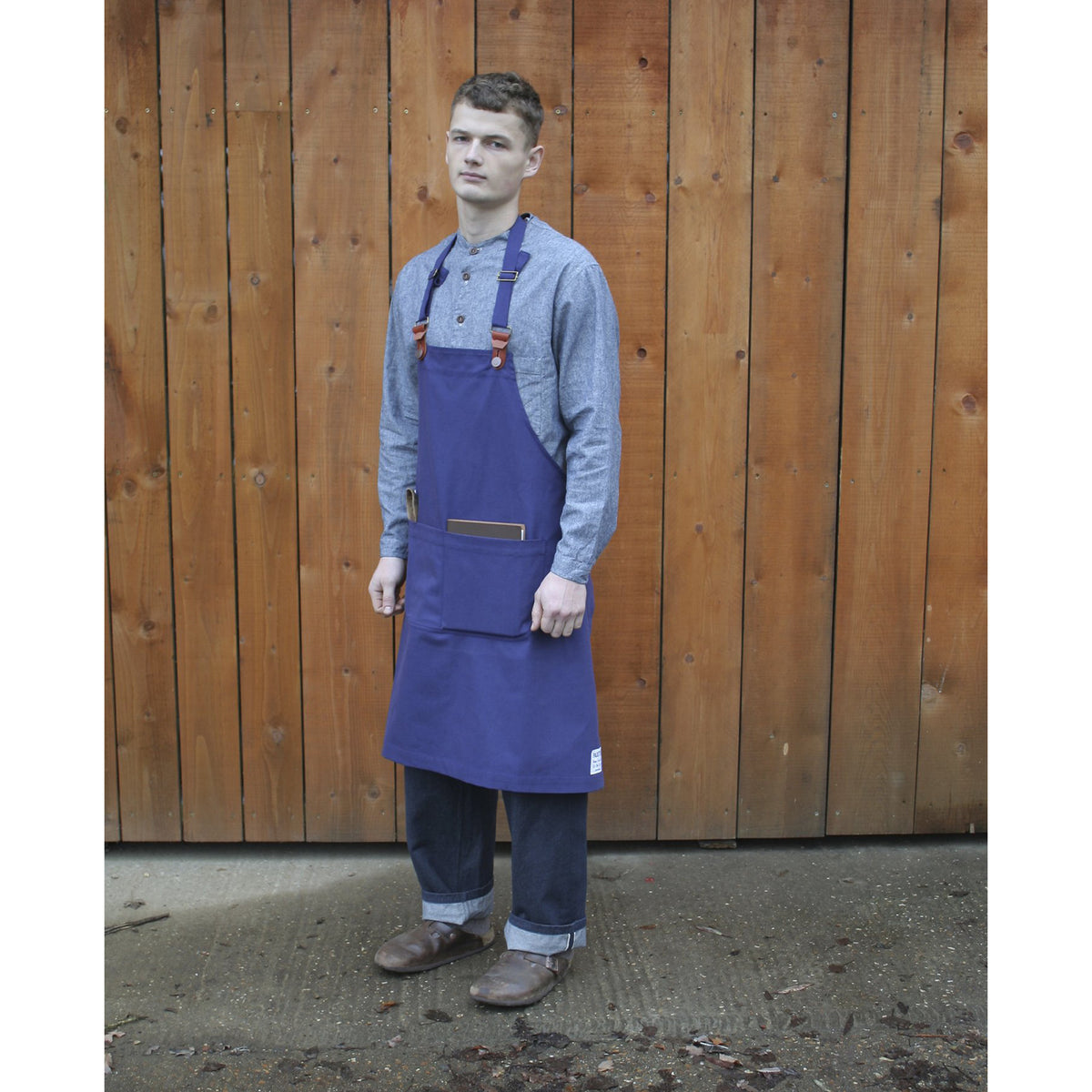 indigo apron worn by a young man