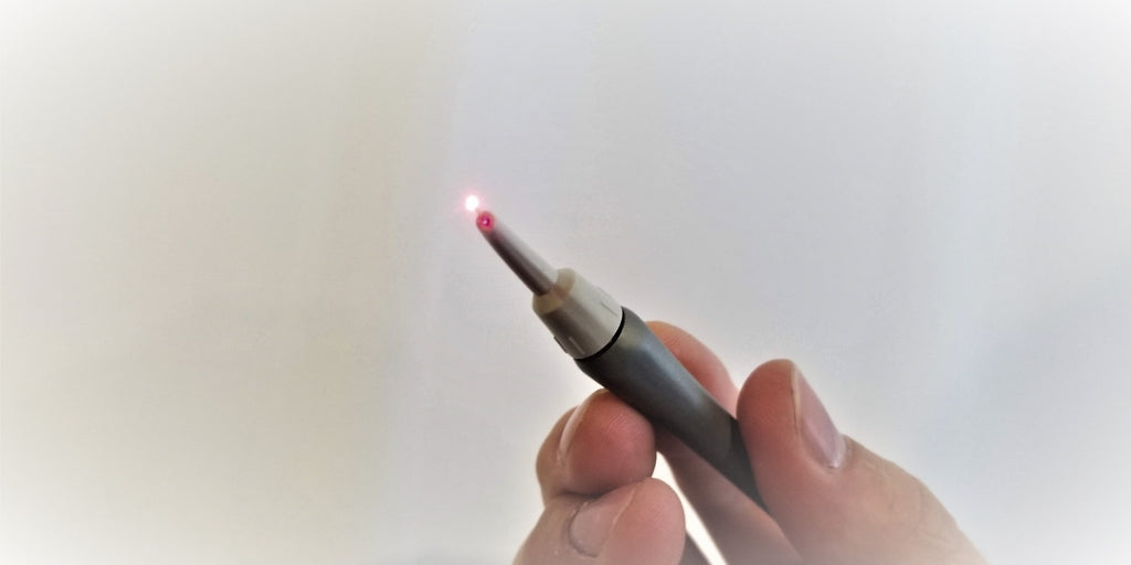 Laser hand piece activated with light coming out