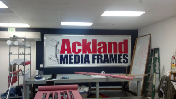 Walls displaying the Ackland Media Frame System. Free ground shipping in U.S.