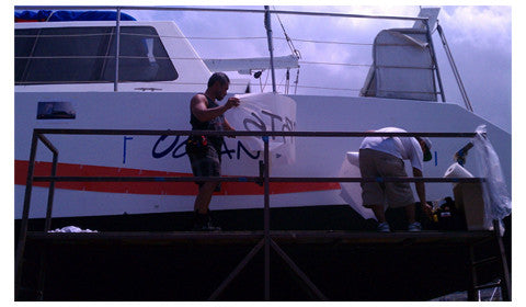 Boat vinyl graphic being installed