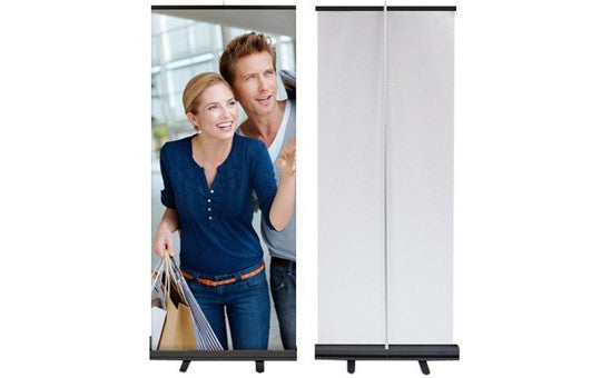 Econoroll 33point5 inch wide retractable banner stand with white back black base
