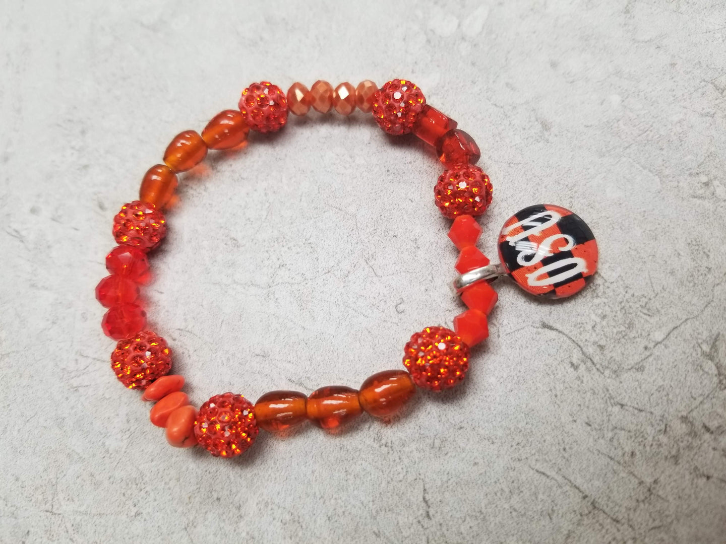 Orange Multi Bead Bracelet with OSU Charm