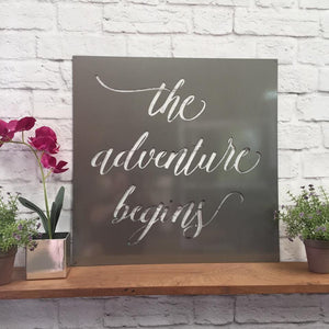 """the Adventure Begins"" Metal Quote Sign"