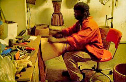 African drum making and drum repairs - Mady Keita in workshop