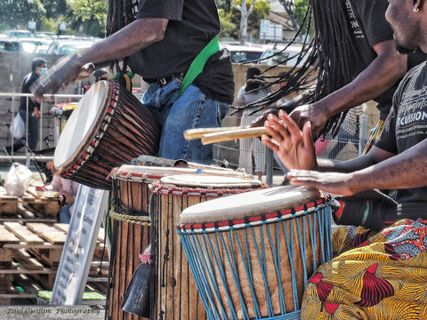 African drumming entertainment at community market event