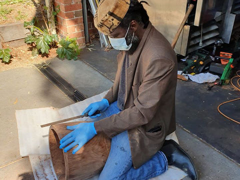 Mady Keita making djembe drum with Covid mask