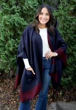 Navy and maroon cape with pockets.