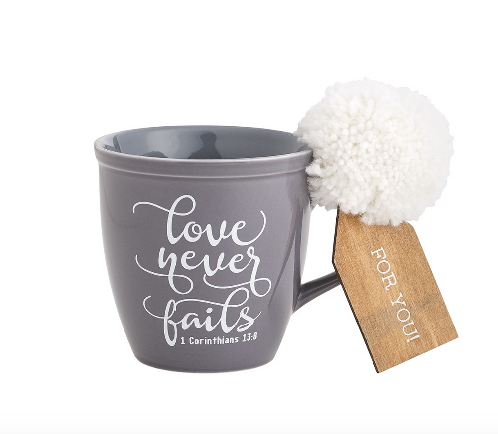 LOVE NEVER FAILS COFFEE MUG