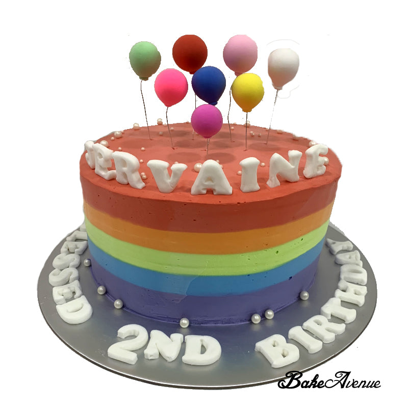Rainbow Cake with balloon toppers