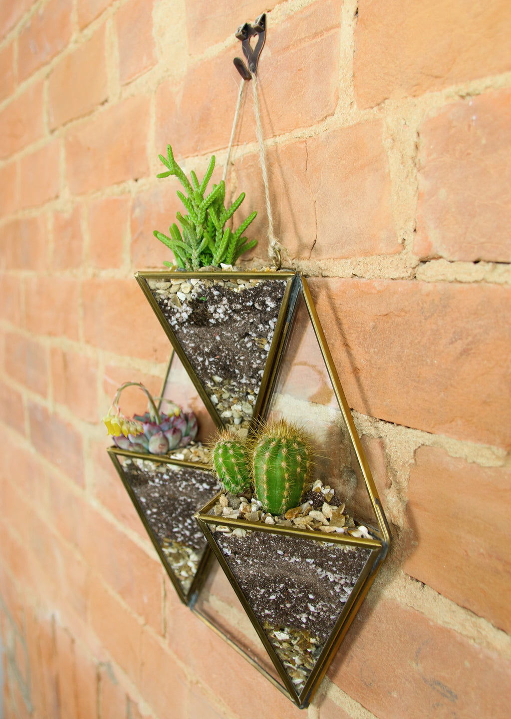 Nkuku brass wall hanging planter