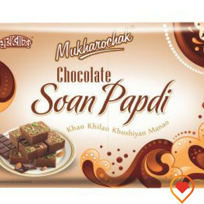 Soan papdi is a popular North Indian dessert. It is usually cube-shaped or served as flakes, and has a crisp and flaky texture, but this time with a chocolaty twist to It, enjoy the very tempting Chocolate Soan Papdi