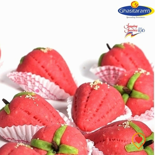 Dryfuits Strawberry made from various dryfruits, milk and sugar, garnished with pistachios. It has a color and shape of strawberry