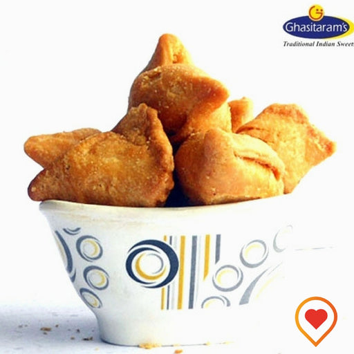 Crispy and Delicious special Ghasitarams Farsan Samosa made from refined flour, Ghee and salt filled with delicious filling.