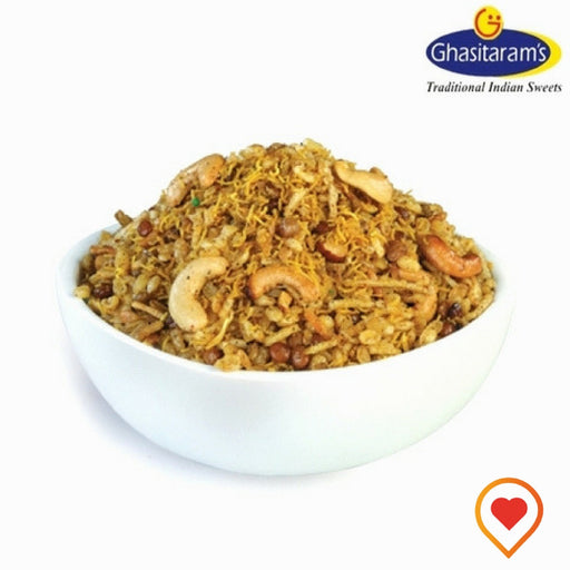 A traditional namkeen from Ghasitaram is specially prepared by adding royal dry fruits, fried lentils, masoor, moong and spices brings about unmatched quality and purity in taste. A spicy and crispy snack with dry fruits makes this savory snack crunchy, tasty and little greasy.