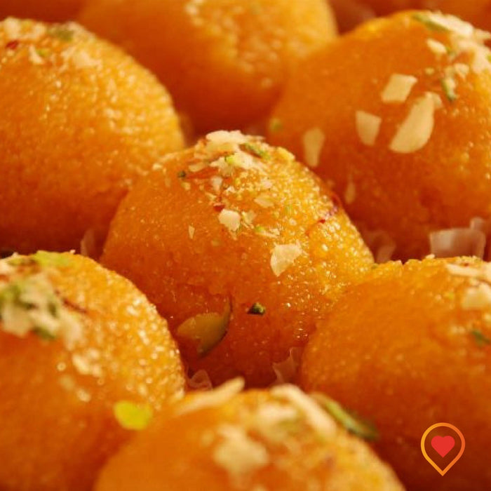 Mixture of gramflour and milk coated with sugar syrup, Loaded with pure ghee