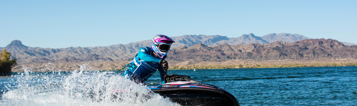 image of a jet skier wearing the Jetpilot Sabre collection.