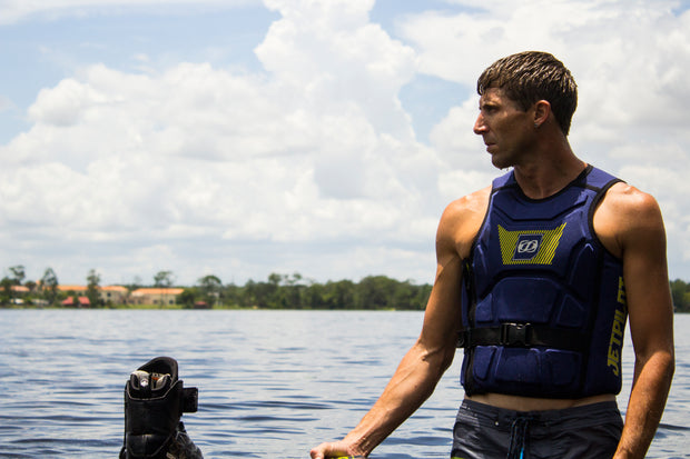 Wakeboarder getting in the water with the A-10 Comp Vest