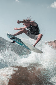 Dylan Ayala airing off a wake with his pro model wake surf