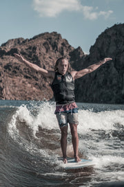 Dylan Ayala hanging ten on his pro model wake surf