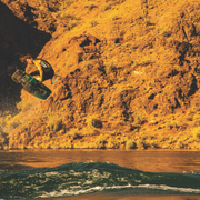 Aaron Rathy wakeboarding doing a big air grab