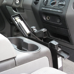 portable gun safe in car front of center console vehicle installation