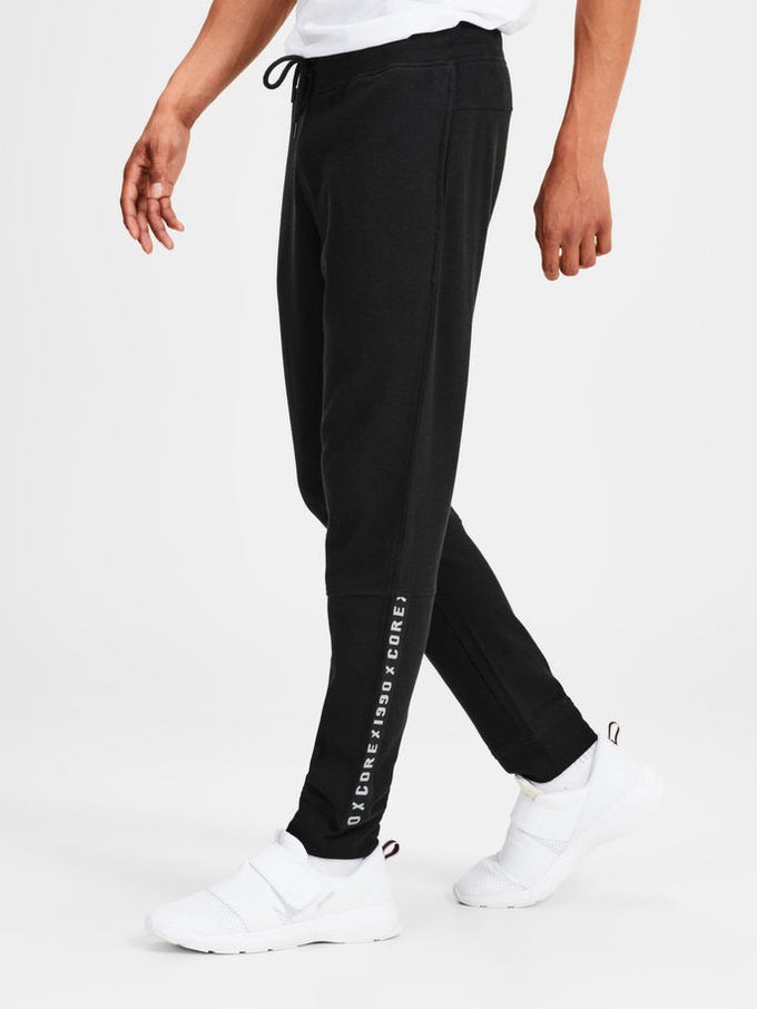 TAPE DETAIL SWEATPANTS Black