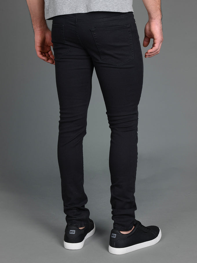 SKINNY FIT RIPPED LIAM 571 JEANS Black