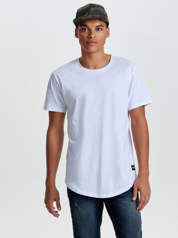 LONG FIT T-SHIRT WITH A CURVED HEMLINE White
