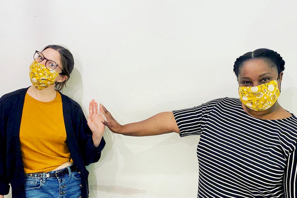 Shannon and Abigail practicing social distancing in their Mustard Floral Masks!