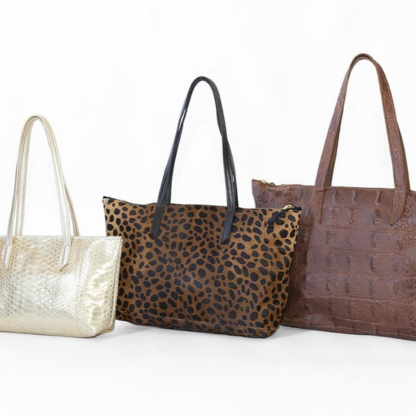 Small in Gold Python, Medium in Brown Cheetah, & Large in Cognac Gator.