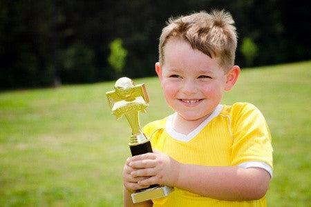 Child with Trophy