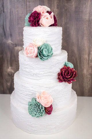 Sola wood flowers on a three-tier cake