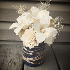 Tin can center piece with sola wood flowers made by a customer.