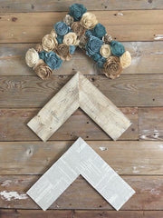 Chevron wall arrows with sola wood flowers made by one of our customers