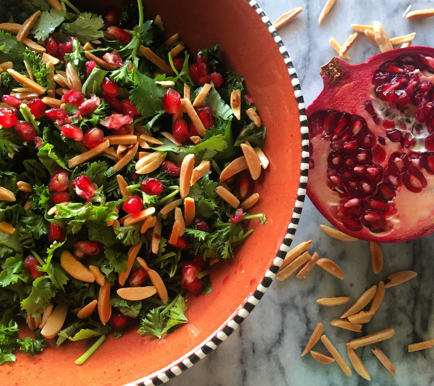 Herb Salad with Chilli Salt Roasted Almonds and a Orange and Pomegranate Dressing