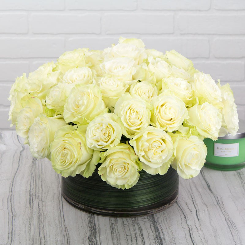 Four Dozen White Roses In A Glass Bowl
