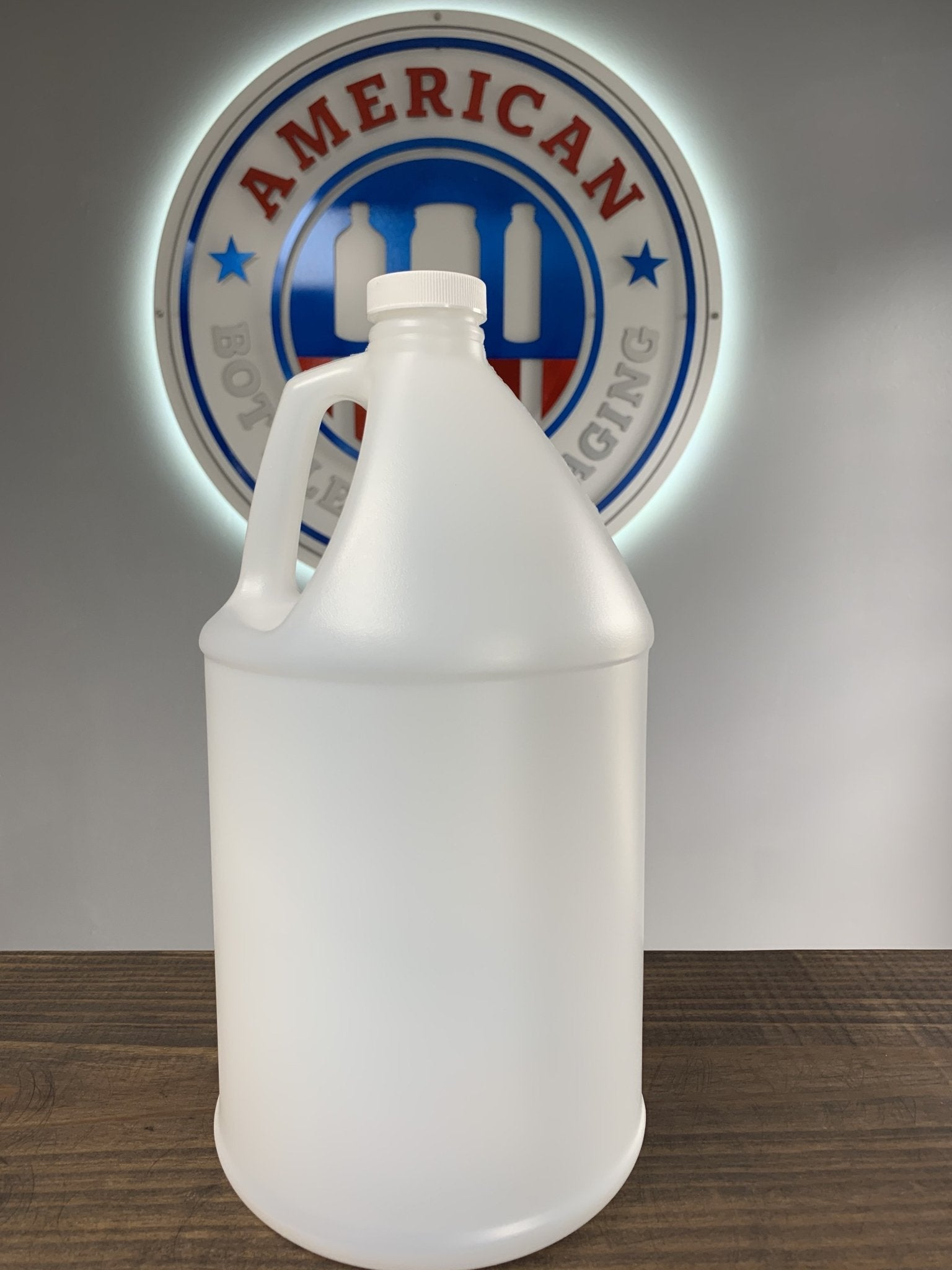 1 Gallon Industrial Round Natural Bottle with 38-400 Neck and White Ribbed Foam Lined Cap - 12,000 per Truckload - Floor Stacked - Rock Bottom Bottles / Packaging Company LLC