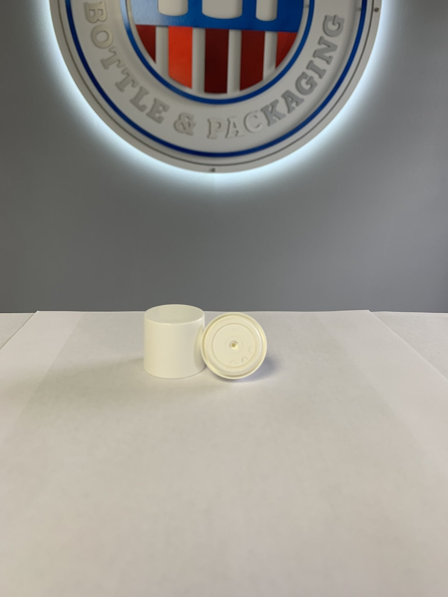 White, round Micro pump head w/white overcap, angle actuator and 300mcl output - CASED 1470 - Rock Bottom Bottles / Packaging Company LLC