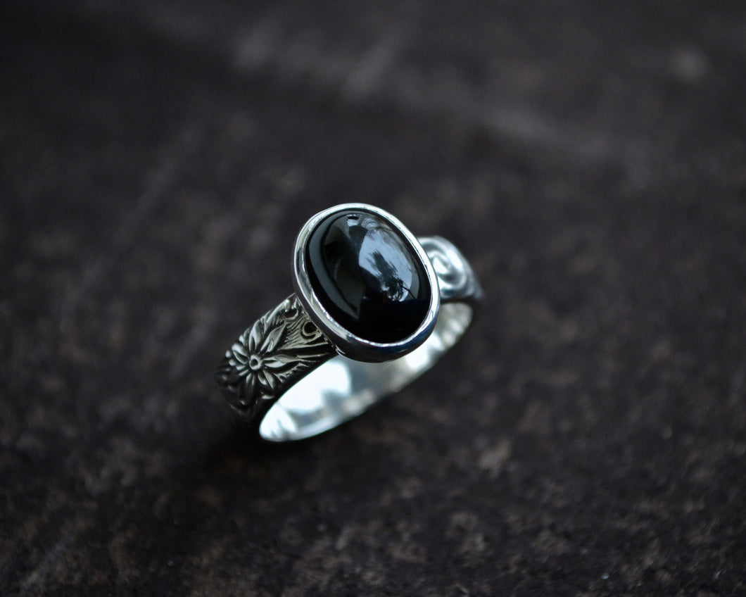 Black Star Diopside Ring On Floral Band