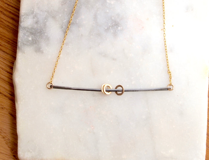 Swing Necklace in  Black + Gold