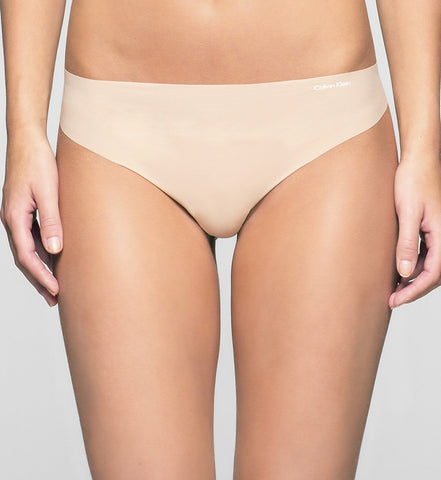 Calvin Klein Women's Invisible Nude/Light Caramel Thong/G-String