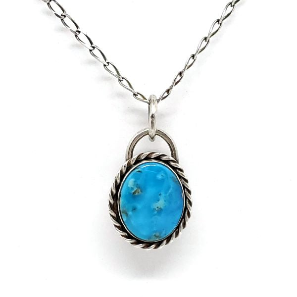 Turquoise Pendant with twisted wire frame