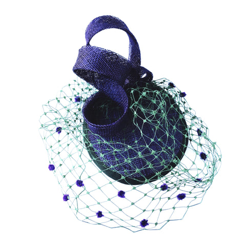 purple hat with green veiling and purple detail ladies fascinator